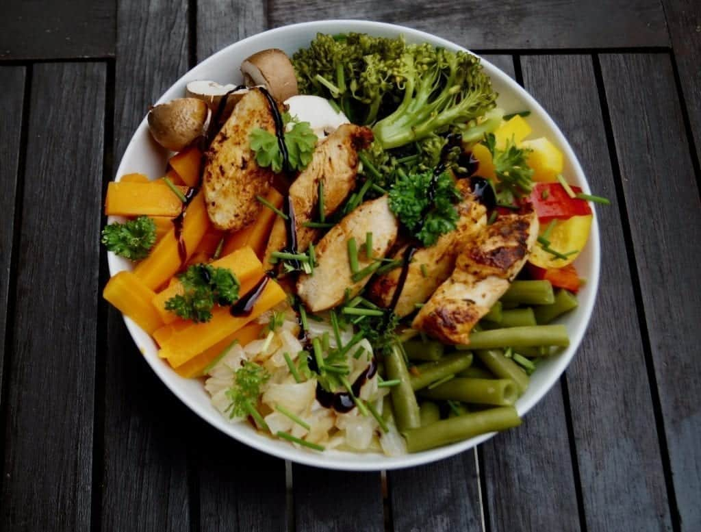 Healthy Buddha Bowl with carrots broccoli and chicken